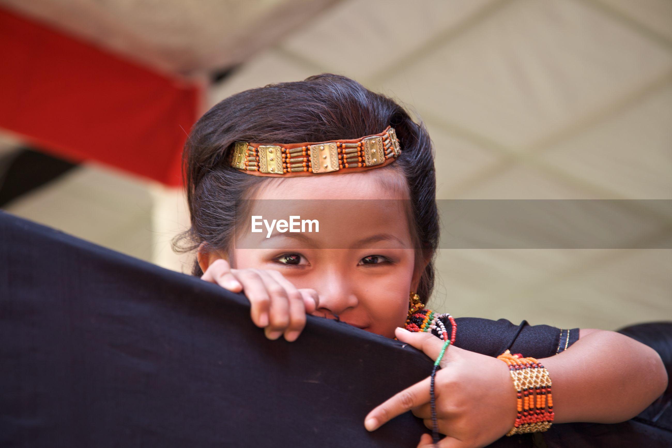 Portrait of cute girl wearing headgear