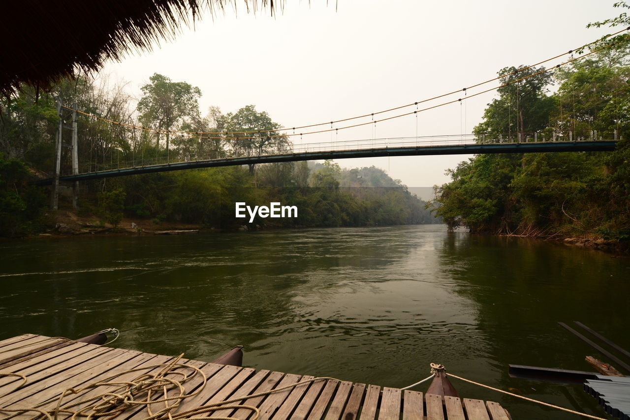 water, tree, bridge, nature, architecture, connection, plant, river, bridge - man made structure, built structure, sky, day, no people, reflection, transportation, outdoors, wood - material, beauty in nature