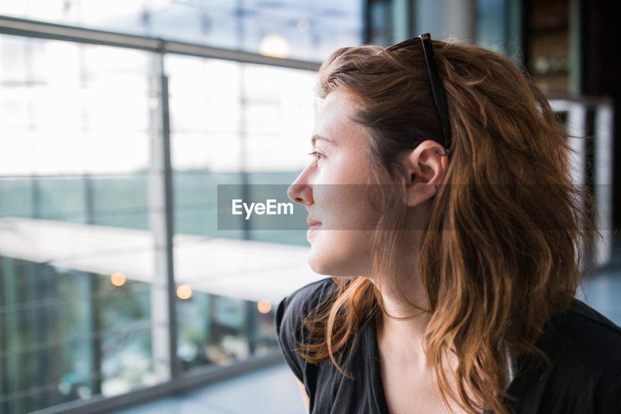 Close-Up Of Young Woman At Airport