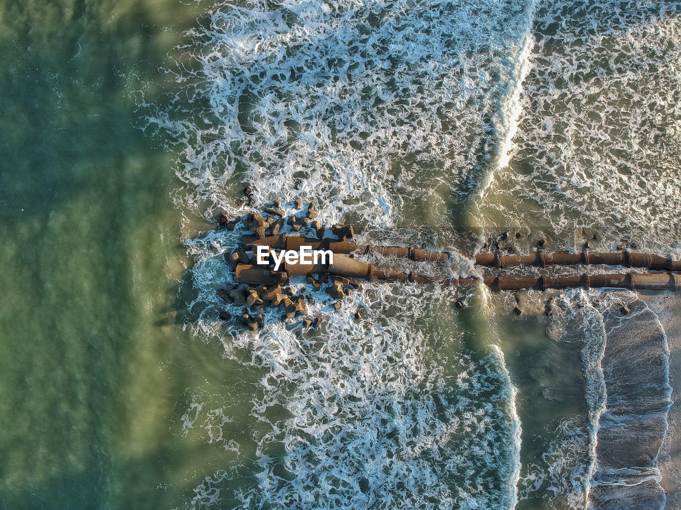 Aerial view of groyne at beach