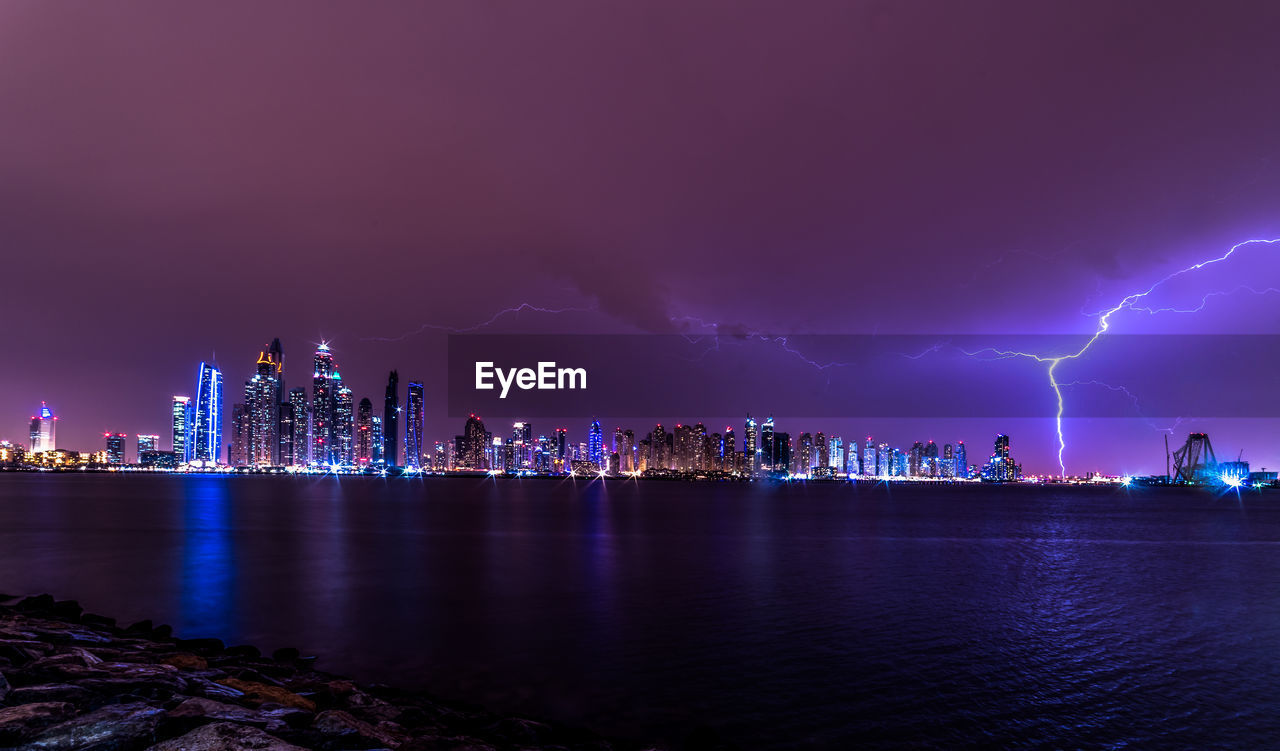 View Of Illuminated Dubai City At Night In Storm