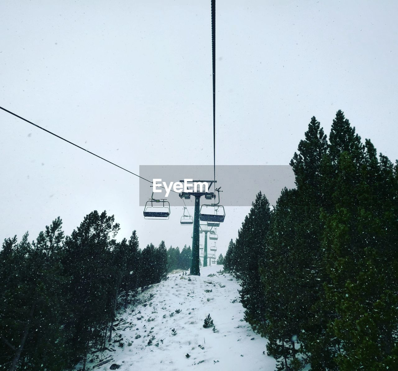 winter, snow, cold temperature, weather, nature, tree, day, beauty in nature, overhead cable car, outdoors, scenics, no people, transportation, sky, ski lift, snowing