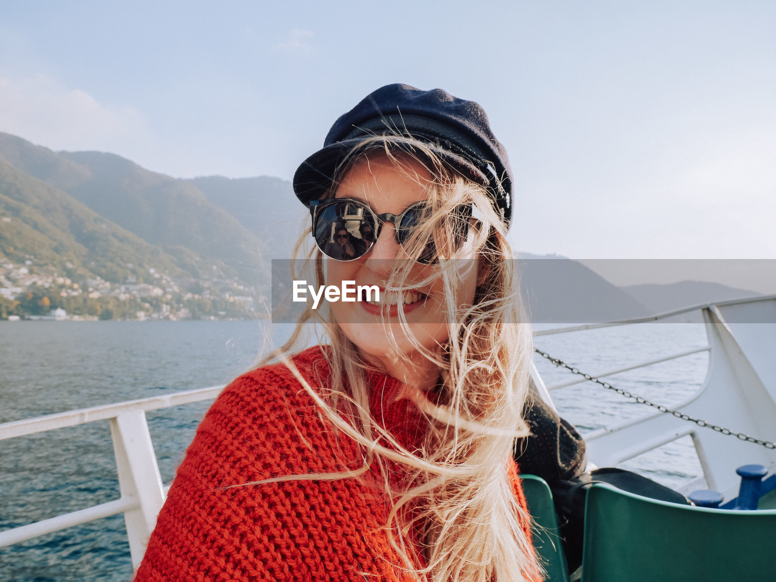 Close-up portrait of smiling young woman on boat sailing in sea