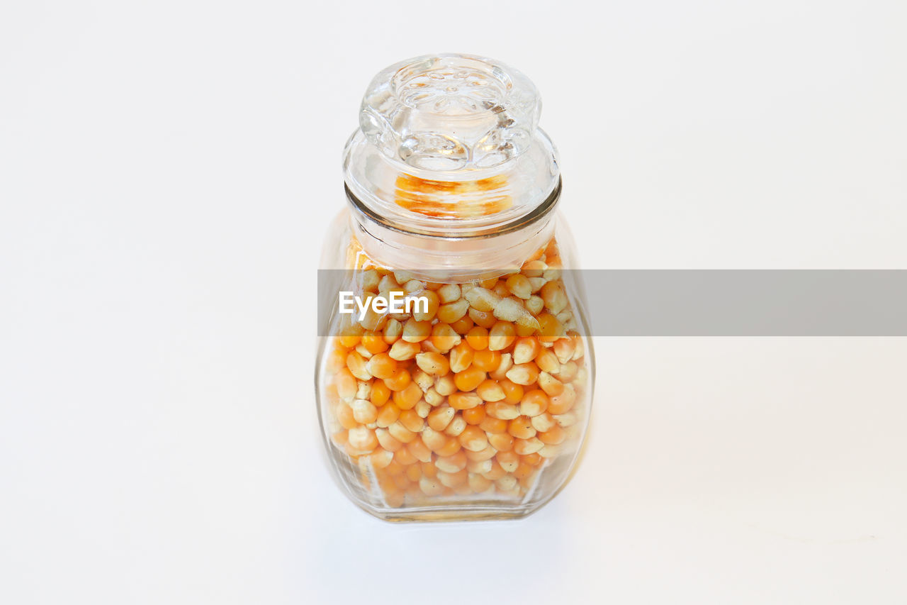 white background, studio shot, container, food and drink, still life, jar, food, glass - material, transparent, indoors, close-up, freshness, no people, wellbeing, cut out, healthy eating, copy space, abundance, large group of objects, high angle view, breakfast, temptation