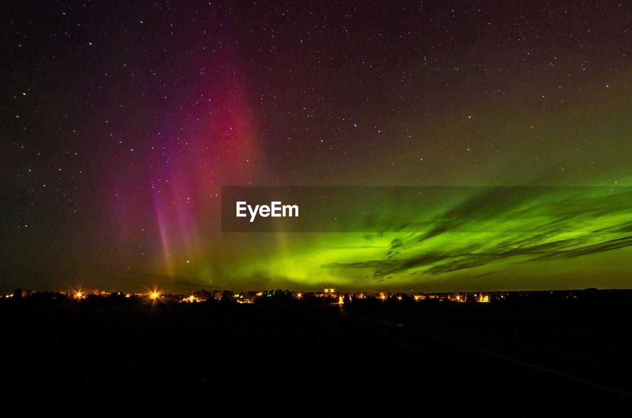 Scenic view of illuminated sky at night