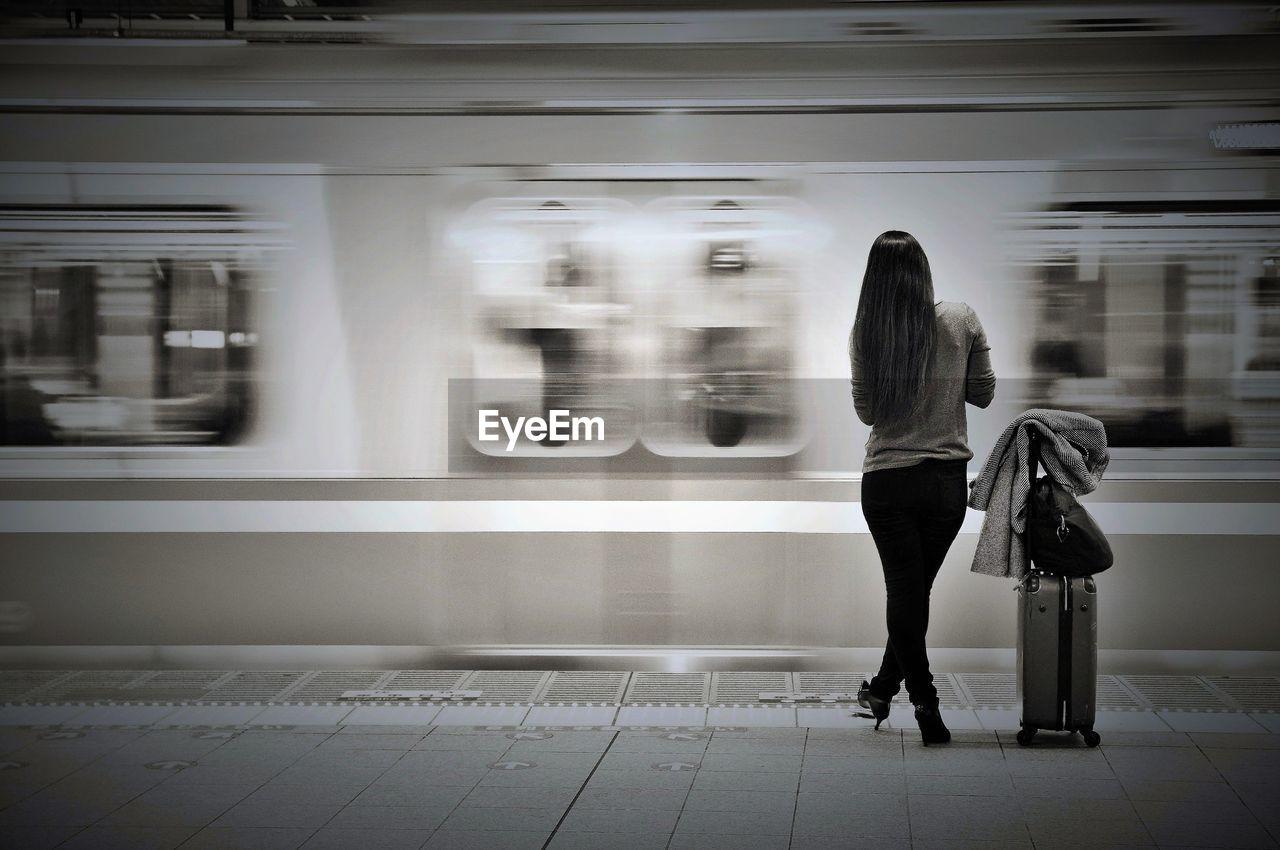 Woman Waiting At Railway Station Platform