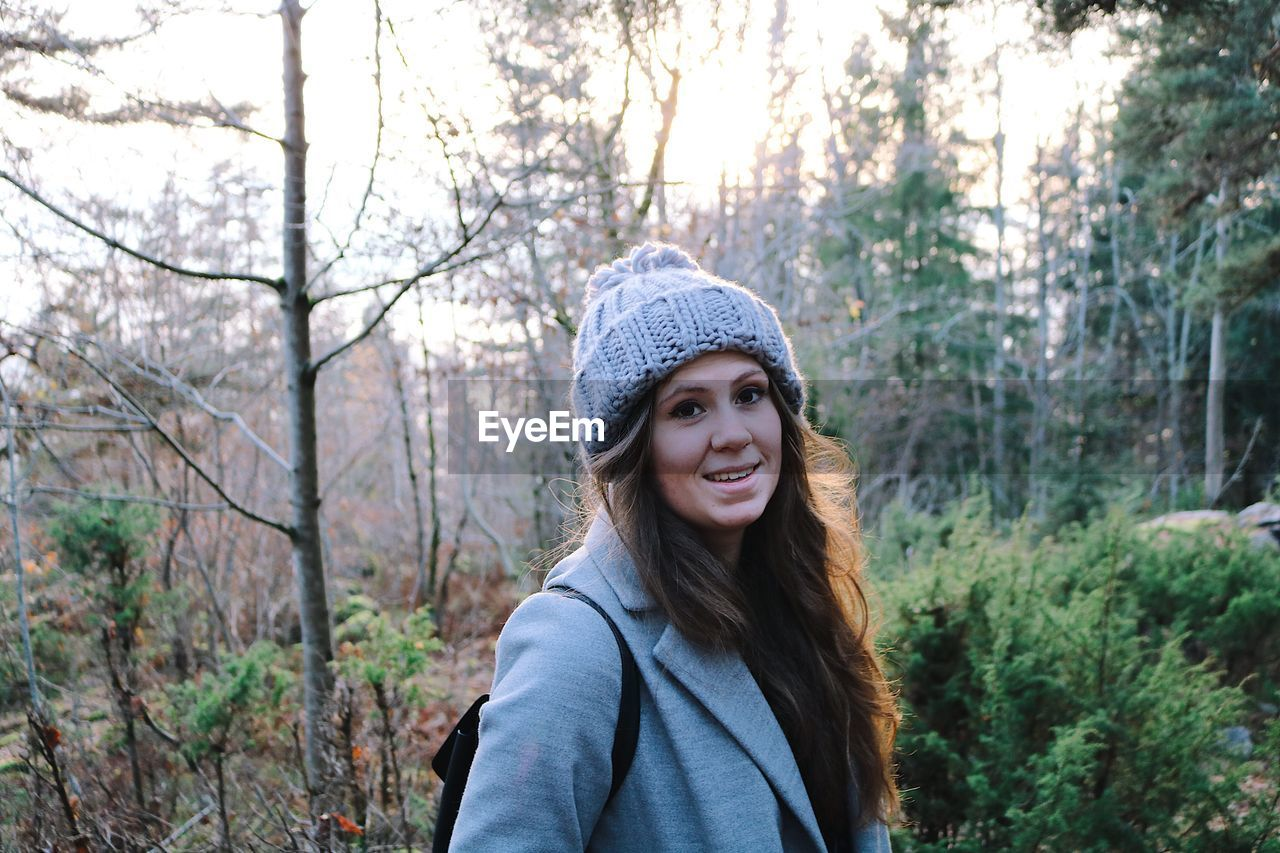 Portrait Of Smiling Woman In Forest