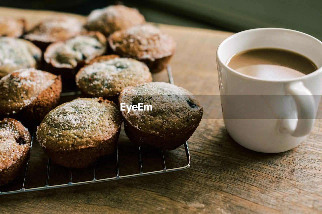 CLOSE-UP OF COFFEE CUP WITH COOKIES