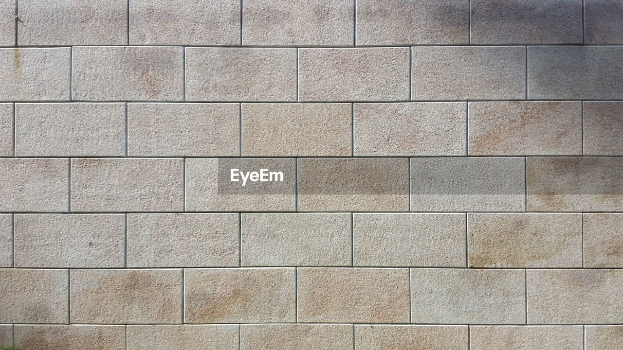backgrounds, full frame, pattern, wall - building feature, architecture, textured, built structure, no people, solid, wall, shape, gray, flooring, design, in a row, material, block, geometric shape, outdoors, tile, stone wall, concrete, textured effect