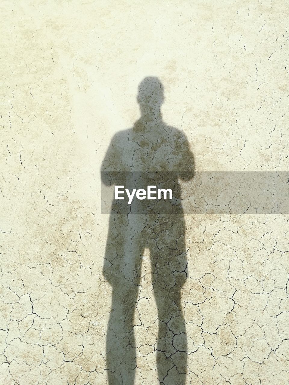 shadow, focus on shadow, sunlight, standing, one person, real people, day, outdoors, men, one man only, adult, adults only, people