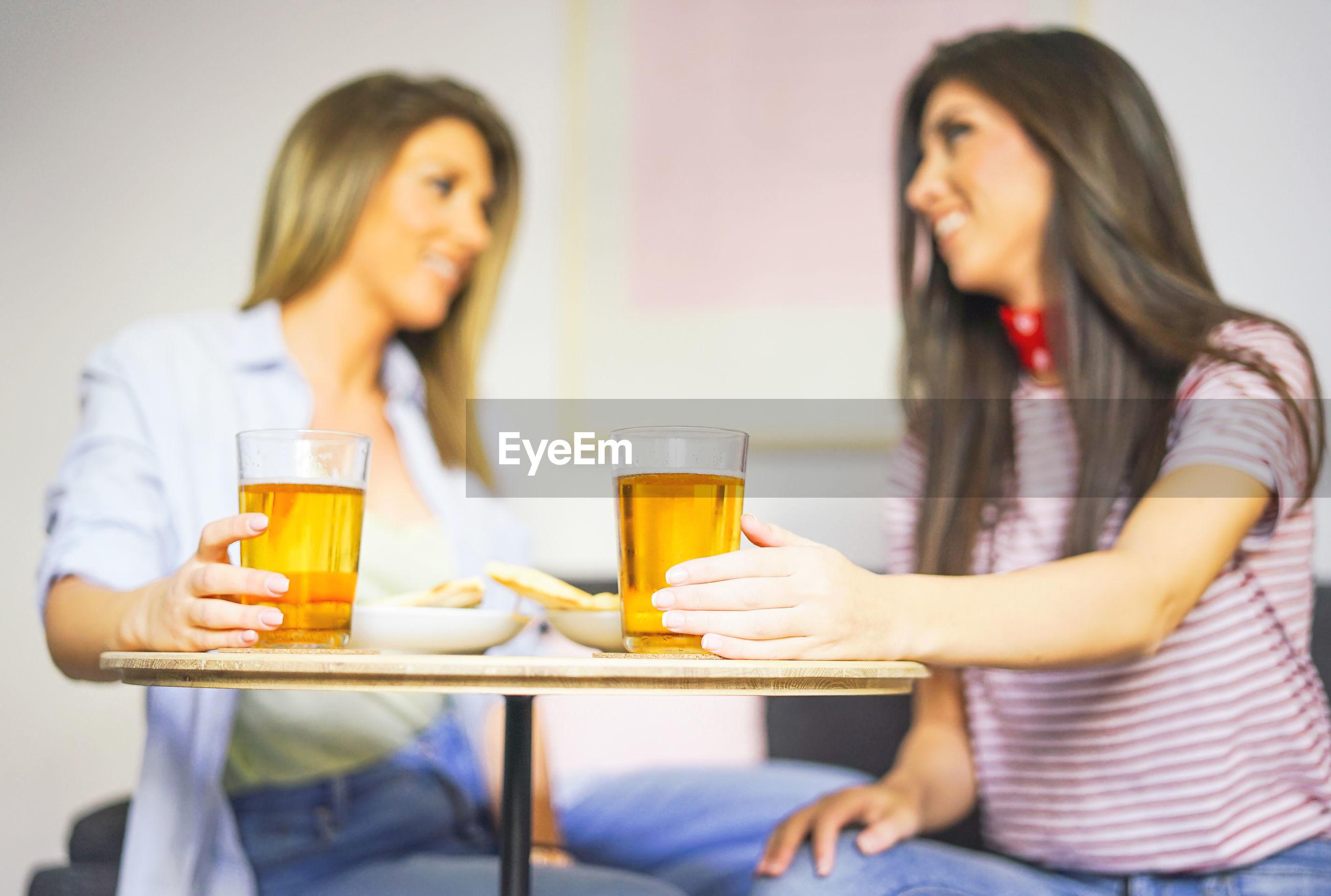 Friends having beer in restaurant