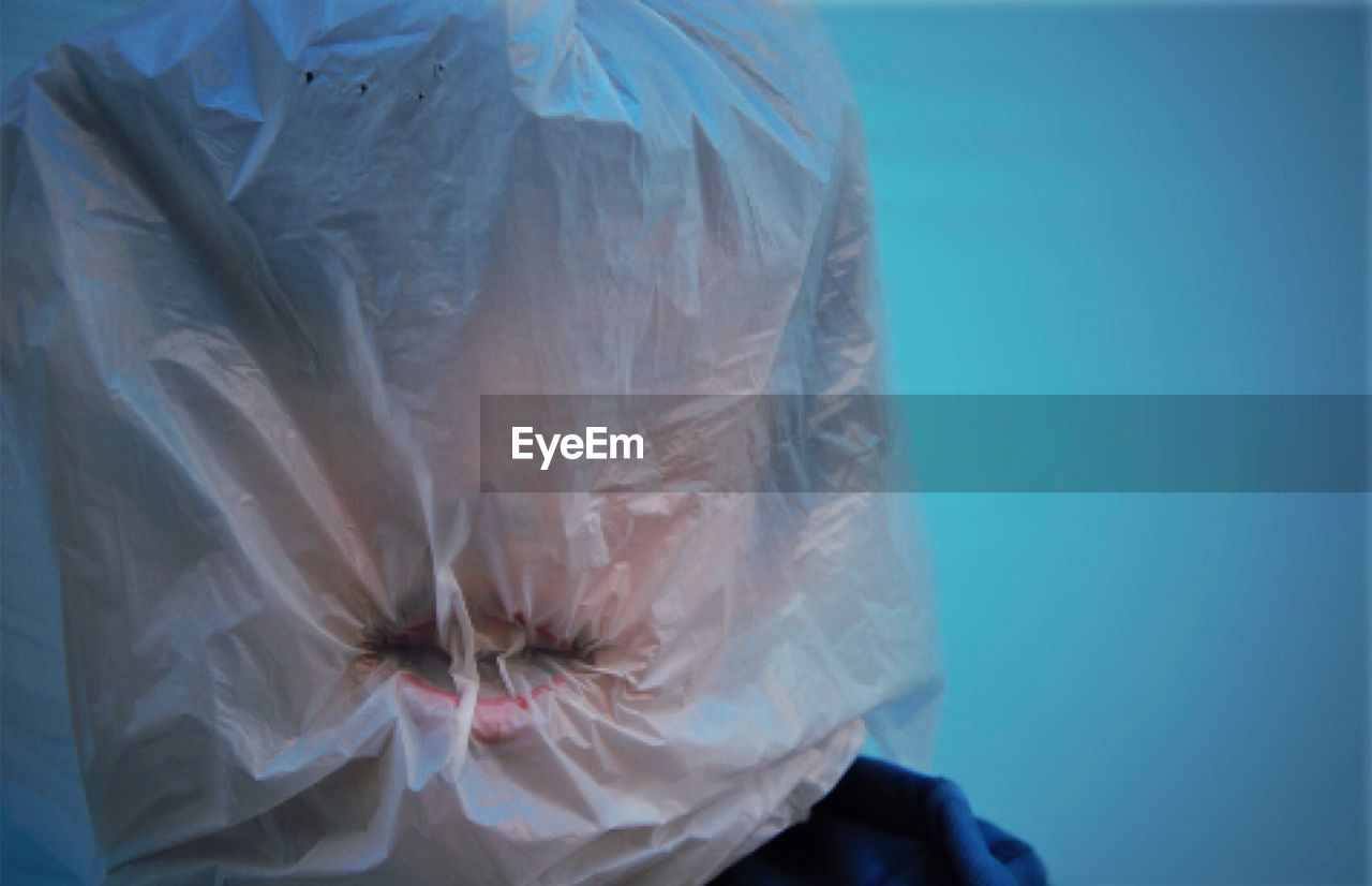 Close-Up Of Person Covered With Plastic Bag