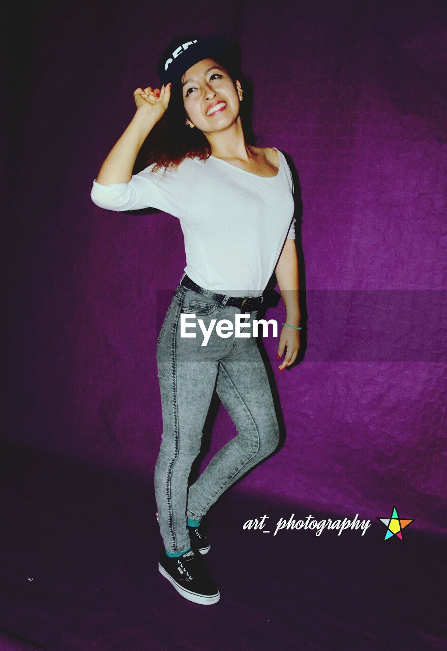indoors, young adult, young women, person, front view, casual clothing, portrait, lifestyles, looking at camera, three quarter length, leisure activity, fashion, sitting, home interior, full length, beauty, standing
