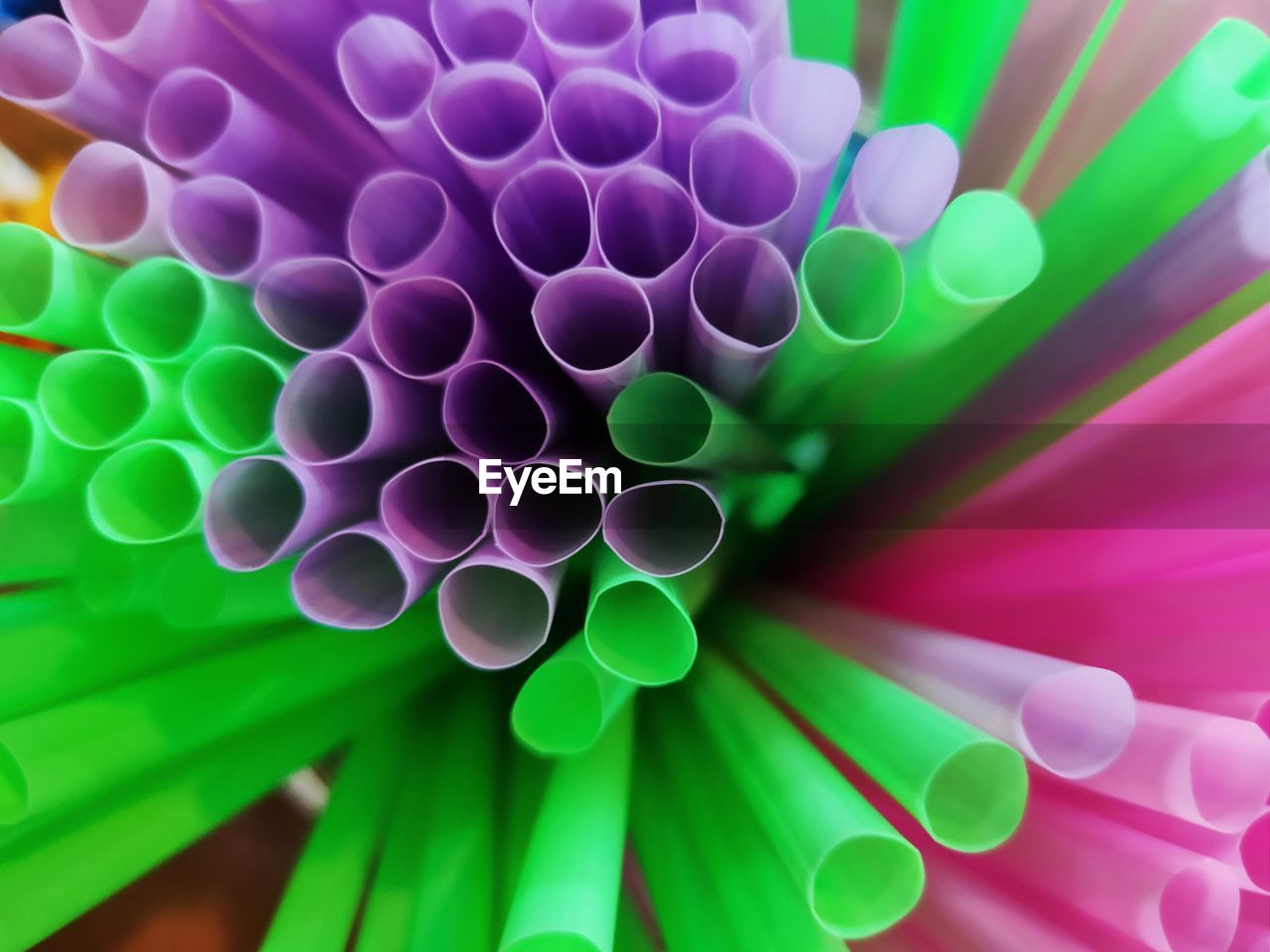 multi colored, drinking straw, no people, straw, pattern, close-up, full frame, shape, green color, circle, geometric shape, backgrounds, design, selective focus, indoors, large group of objects, abstract, abundance, plastic, still life, purple