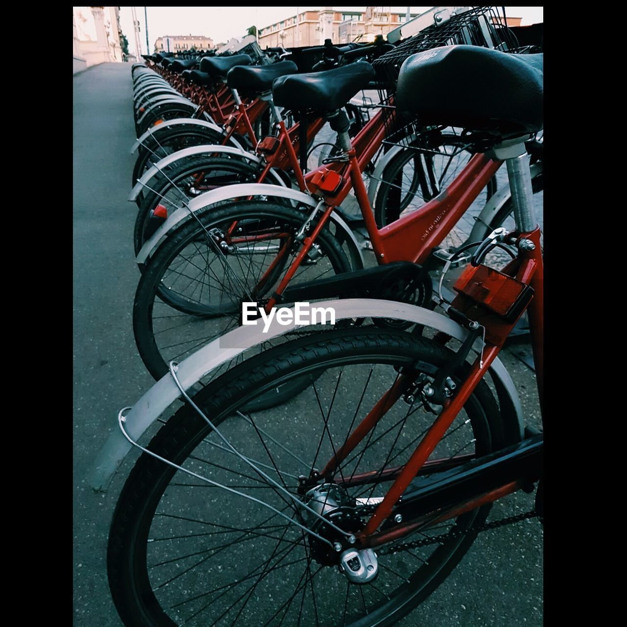 bicycle, transportation, mode of transport, land vehicle, stationary, bicycle rack, day, parking, no people, outdoors, red, spoke