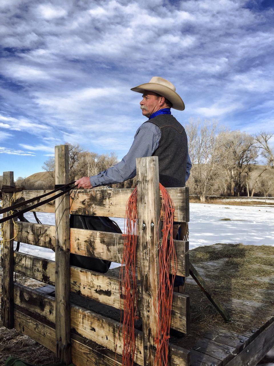 Senior Cowboy At Ranch Against Sky