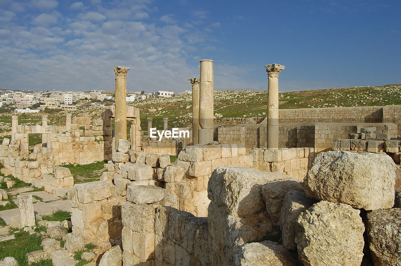 history, architecture, the past, built structure, ancient, solid, sky, old ruin, nature, ancient civilization, tourism, building exterior, travel destinations, day, travel, old, rock, sunlight, rock - object, architectural column, no people, archaeology, outdoors, ruined, deterioration, stone wall