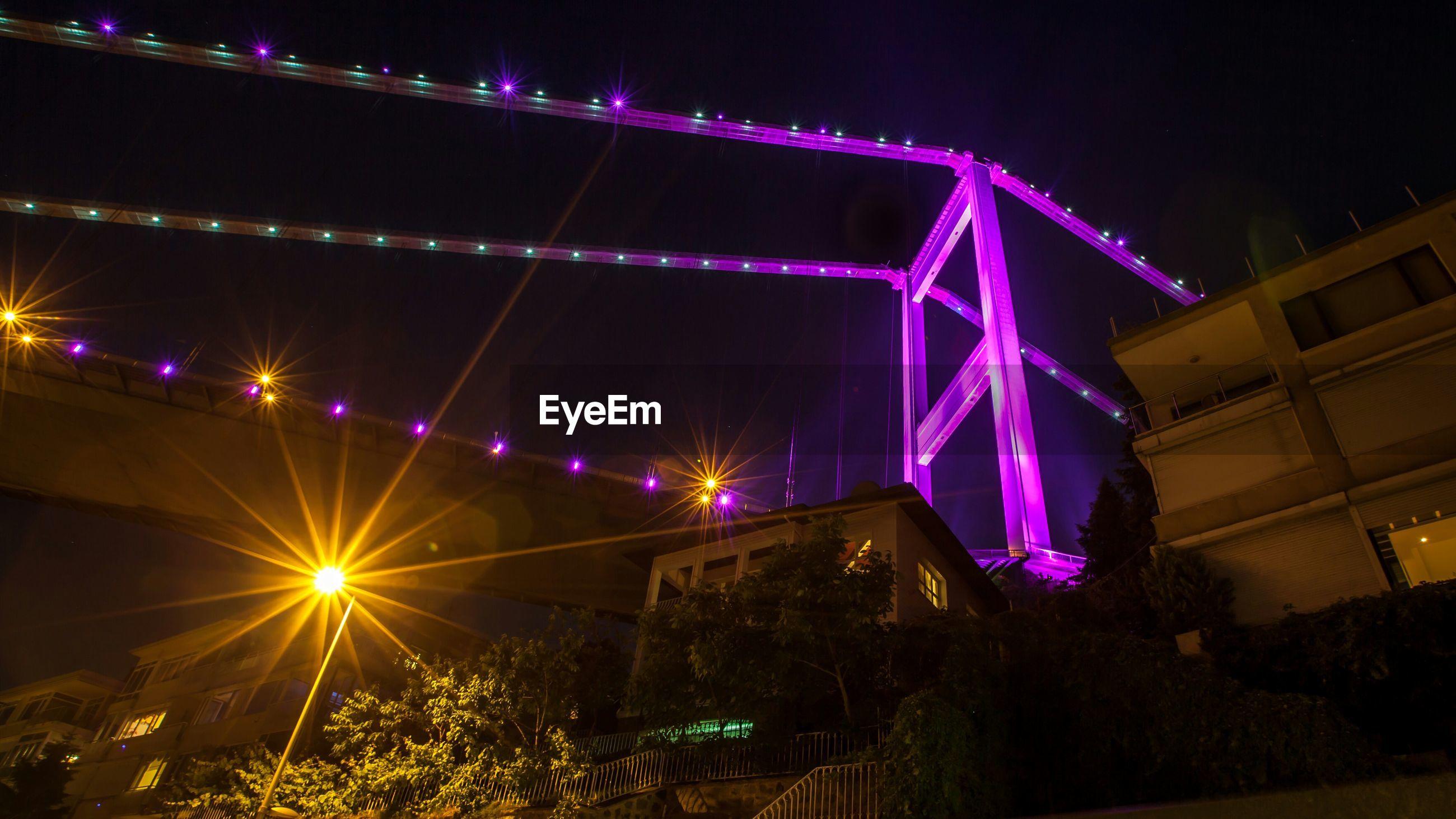 Low angle view of illuminated bosphorus bridge at night