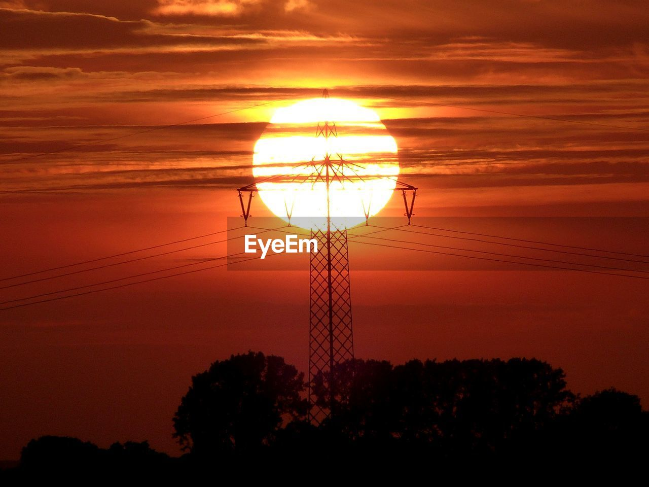 sunset, silhouette, orange color, fuel and power generation, cable, nature, sky, electricity pylon, electricity, no people, sun, scenics, power supply, tree, tranquility, beauty in nature, low angle view, outdoors, technology, day