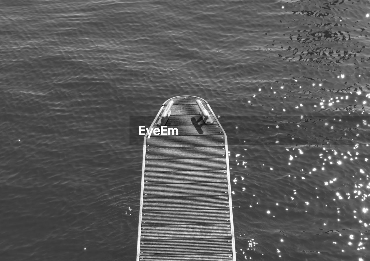High angle view of empty pier over sea on sunny day