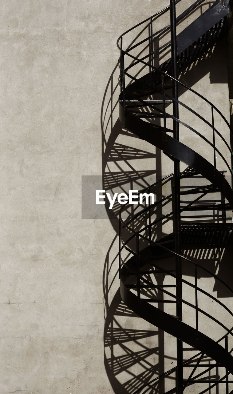 architecture, staircase, steps and staircases, built structure, no people, railing, spiral, absence, spiral staircase, wall - building feature, metal, day, shadow, indoors, building, sunlight, nature, pattern, wrought iron