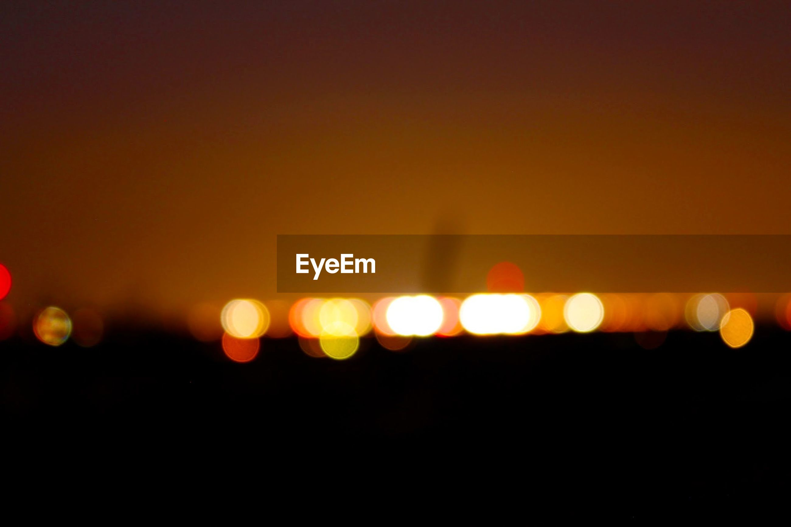 sunset, copy space, orange color, illuminated, defocused, sun, circle, night, dark, beauty in nature, scenics, clear sky, glowing, no people, nature, tranquility, silhouette, idyllic, sky, outdoors