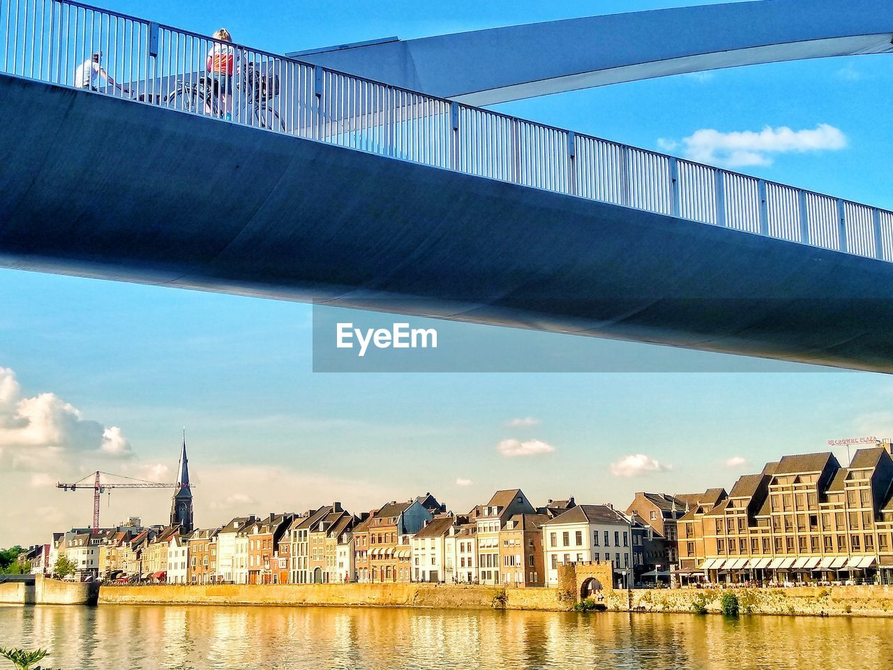 architecture, built structure, water, building exterior, connection, sky, bridge, nature, transportation, bridge - man made structure, river, city, day, waterfront, travel destinations, cloud - sky, travel, engineering, outdoors
