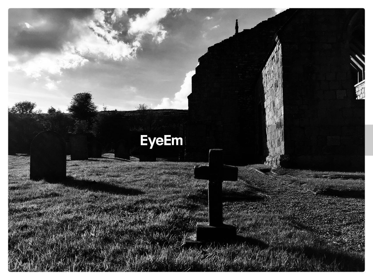 religion, grave, cross, cemetery, spirituality, belief, stone, grass, tombstone, sky, transfer print, architecture, memorial, plant, history, cloud - sky, no people, outdoors, symbol