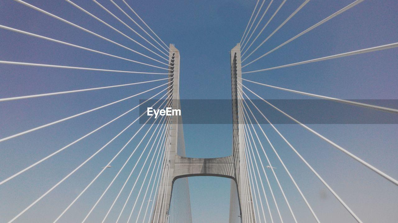 Low Angle View Of 25 De Abril Bridge Against Sky