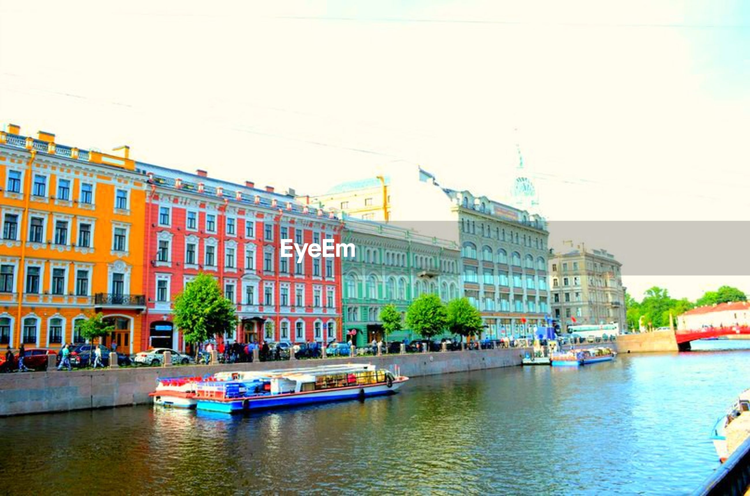 building exterior, architecture, built structure, water, waterfront, transportation, nautical vessel, mode of transport, tree, boat, city, canal, river, incidental people, clear sky, sky, residential building, building, moored, house