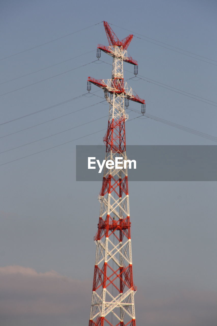 sky, low angle view, built structure, nature, tall - high, architecture, no people, tower, technology, metal, connection, day, outdoors, cable, electricity pylon, electricity, communication, fuel and power generation, red, electrical equipment, power supply