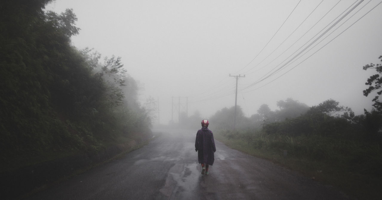Man On Road In Rain