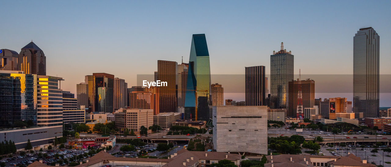 Modern Buildings Against Clear Sky During Sunset