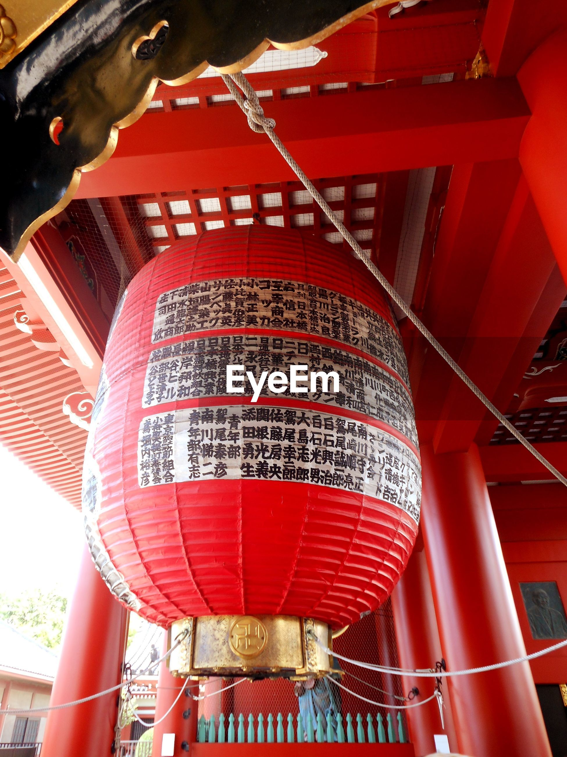 Low angle view of lantern hanging at ceiling