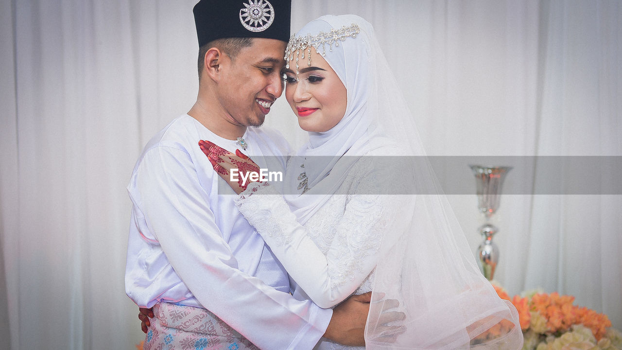togetherness, two people, women, celebration, love, wedding, young adult, bonding, event, adult, real people, young women, young men, bride, lifestyles, couple - relationship, wedding dress, newlywed, life events, men, positive emotion, wedding ceremony
