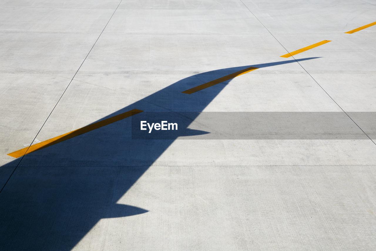 Shadow Of Airplane On Runway