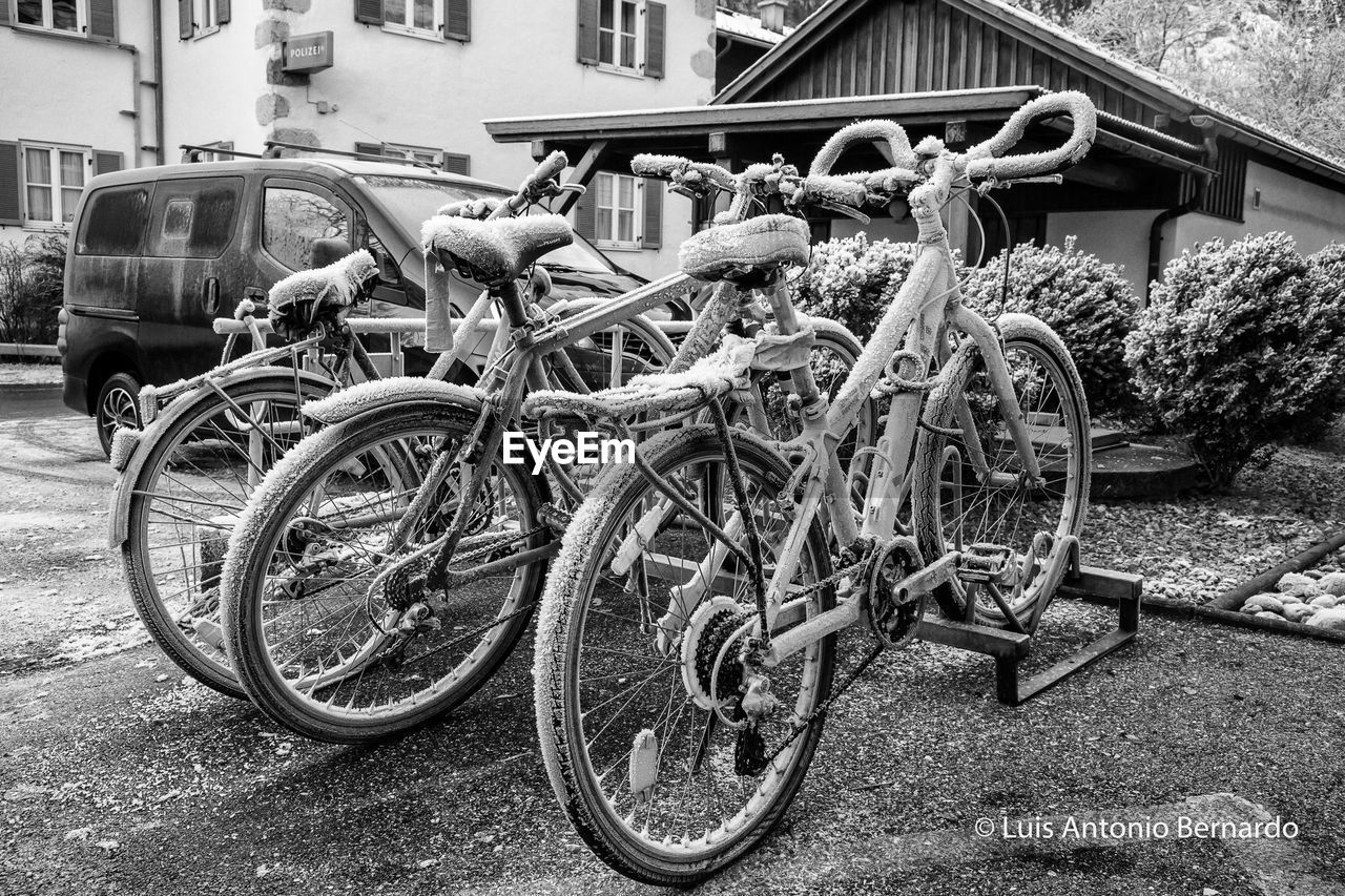 transportation, bicycle, mode of transport, land vehicle, outdoors, day, building exterior, stationary, no people, built structure, architecture, bicycle rack, wheel, close-up