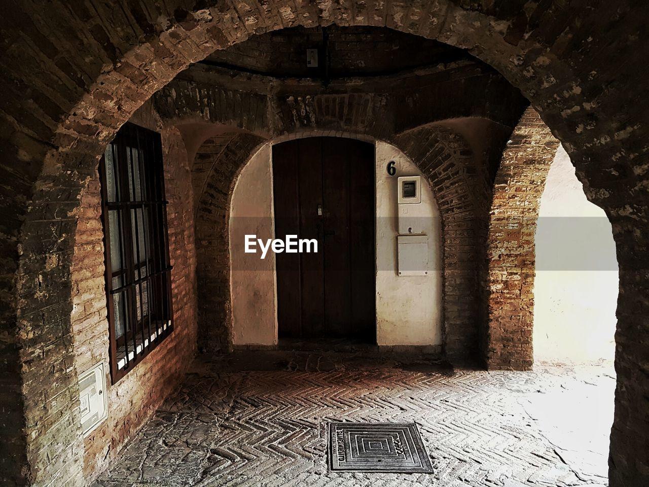 arch, architecture, indoors, door, built structure, day, doorway, no people