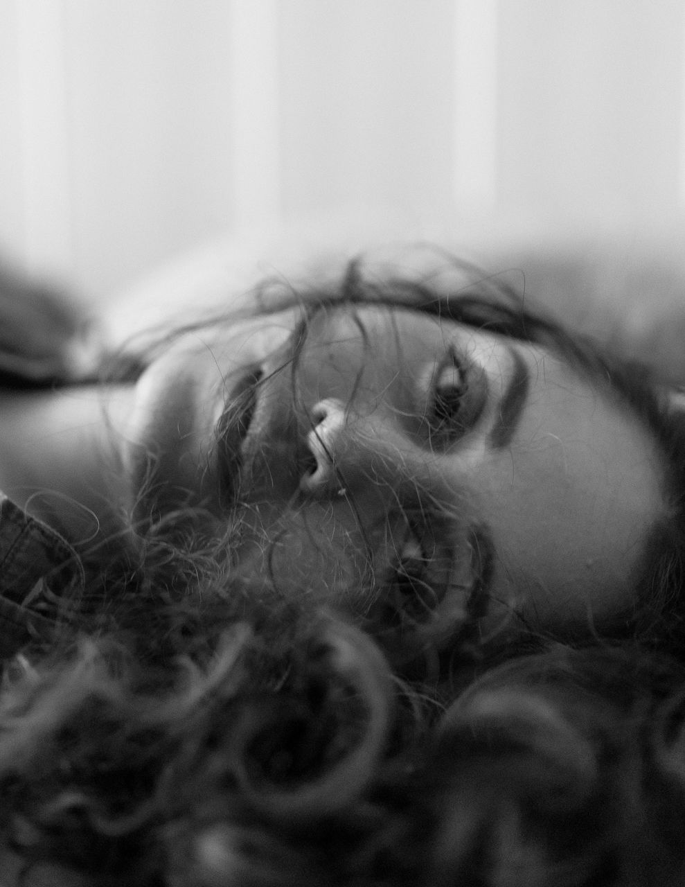 Close-up portrait of woman lying down