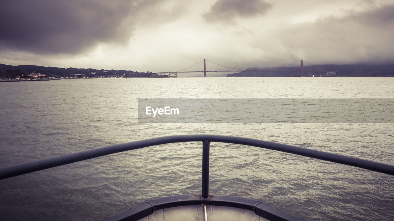 water, sky, transportation, cloud - sky, sea, nature, built structure, nautical vessel, mode of transportation, no people, bridge, beauty in nature, bridge - man made structure, travel, architecture, connection, outdoors, travel destinations, bay, sailboat
