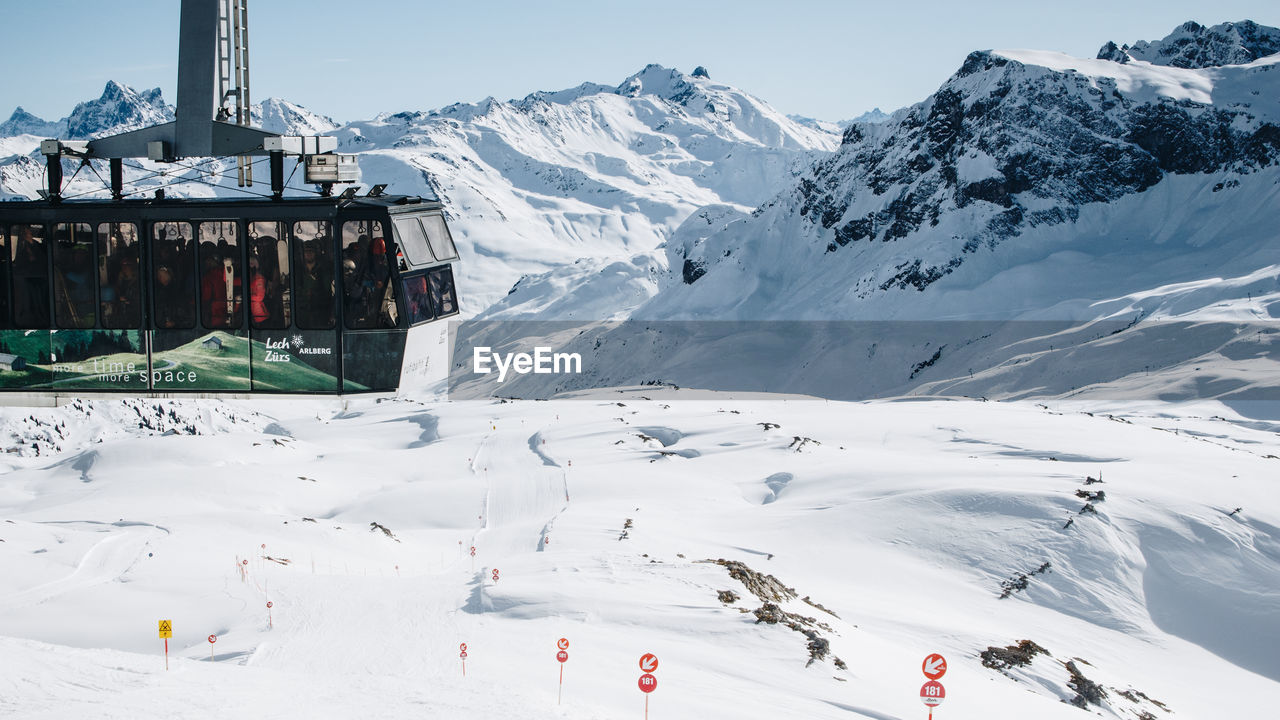 AERIAL VIEW OF SKI LIFT OVER SNOWCAPPED MOUNTAINS
