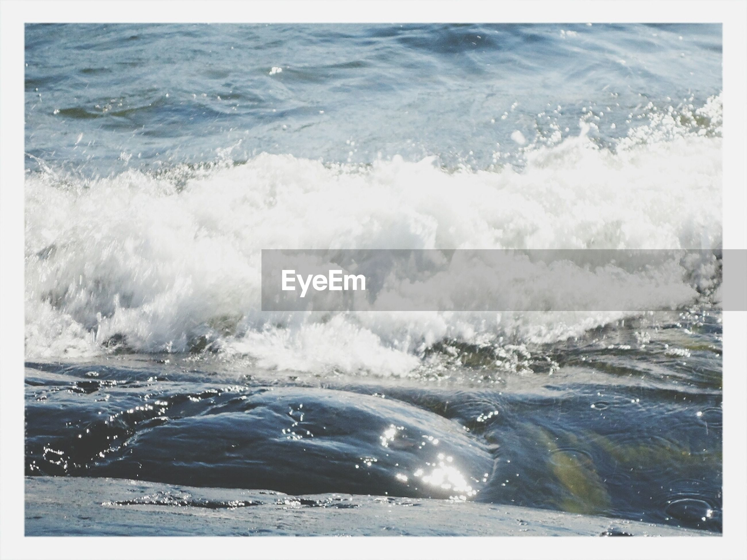 water, sea, surf, transfer print, wave, auto post production filter, motion, beauty in nature, shore, beach, nature, scenics, tranquility, splashing, tranquil scene, day, high angle view, outdoors, coastline, no people