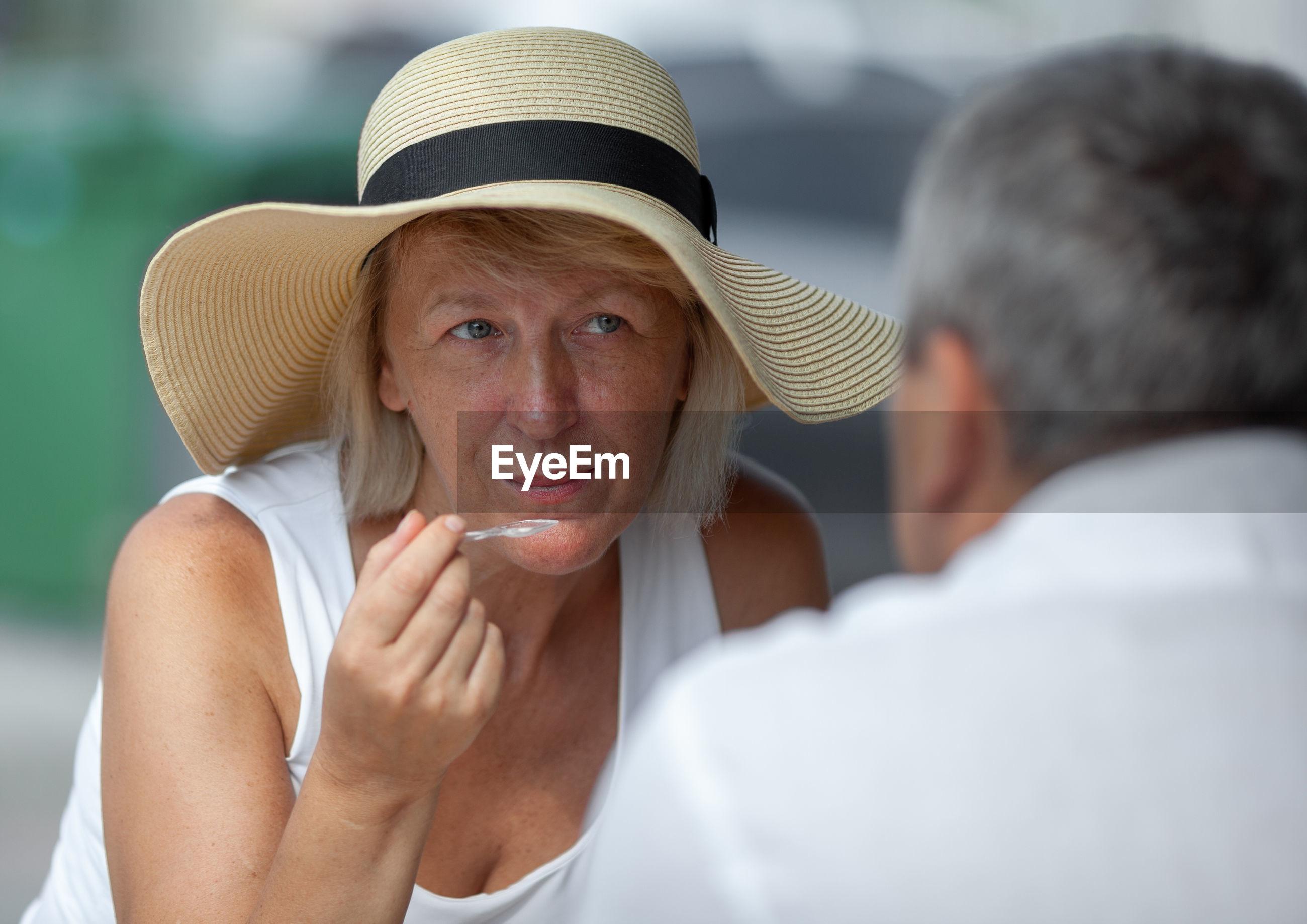 Woman looking at husband while talking