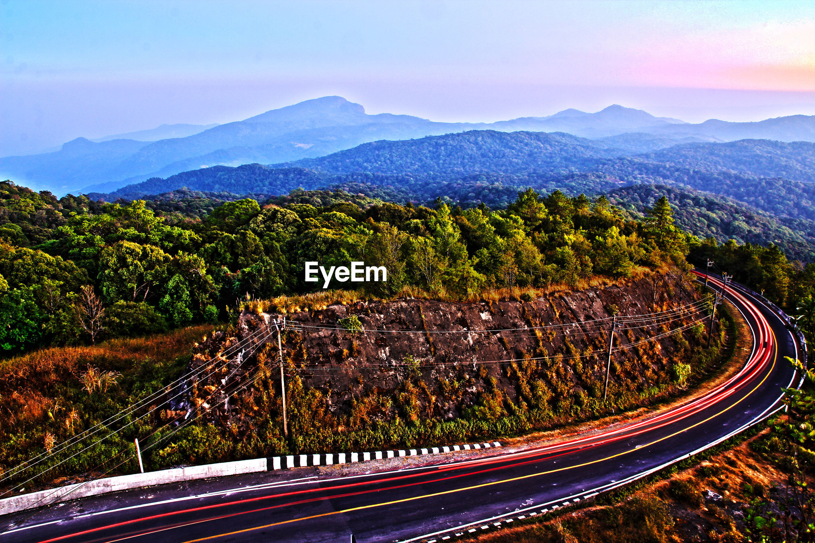 HIGH ANGLE VIEW OF ROAD ON MOUNTAIN