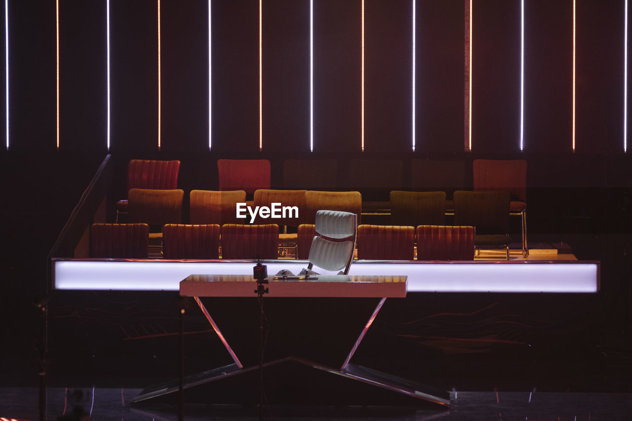 chair, seat, empty, no people, absence, auditorium, indoors, stage - performance space, day