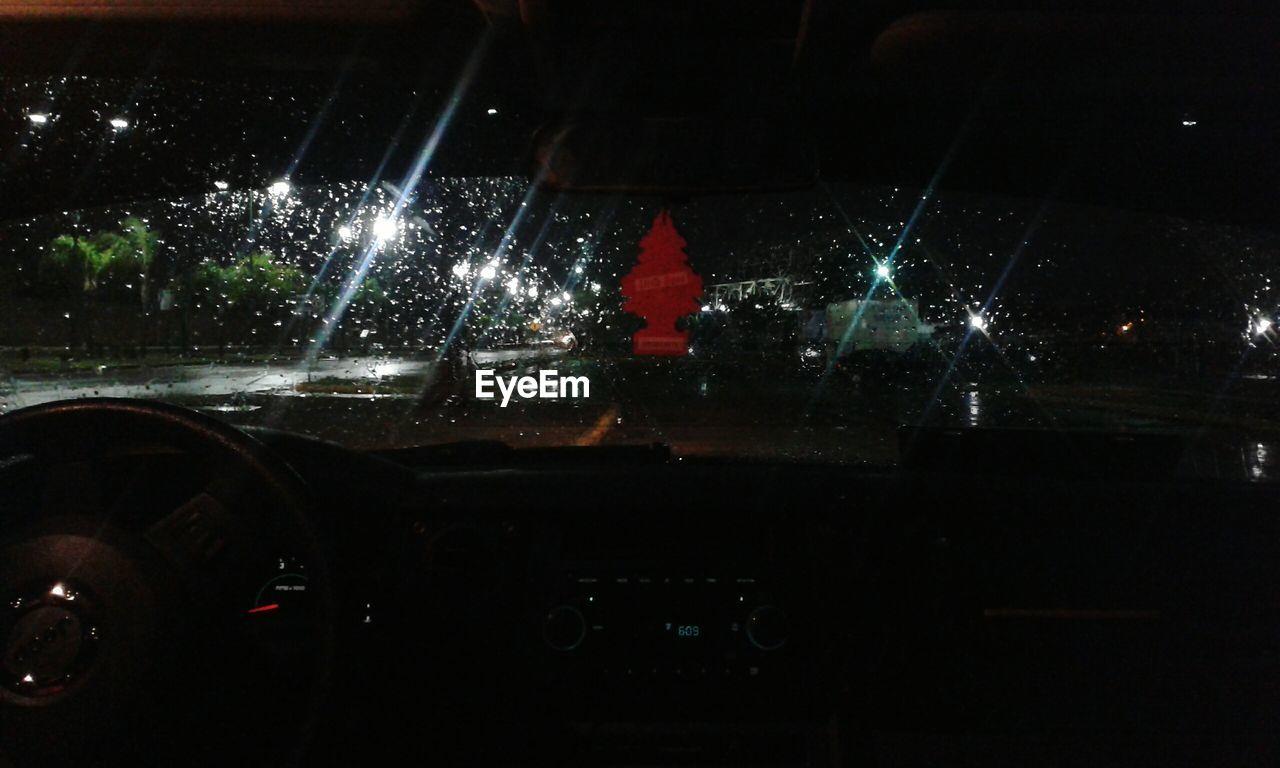 night, illuminated, car, car interior, transportation, windshield, land vehicle, no people, water, indoors