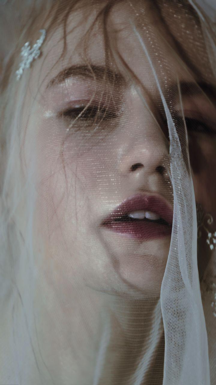 Close-Up Portrait Of Bride Wearing Veil