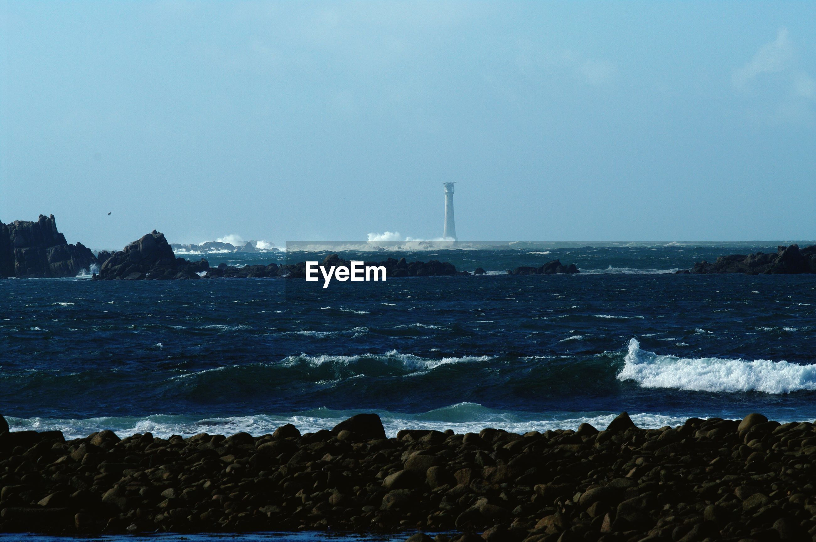 sea, blue, water, shore, tranquil scene, beach, tranquility, nature, scenics, wave, coastline, beauty in nature, day, distant, sky, outdoors, seascape, ocean, remote, no people, non-urban scene, solitude