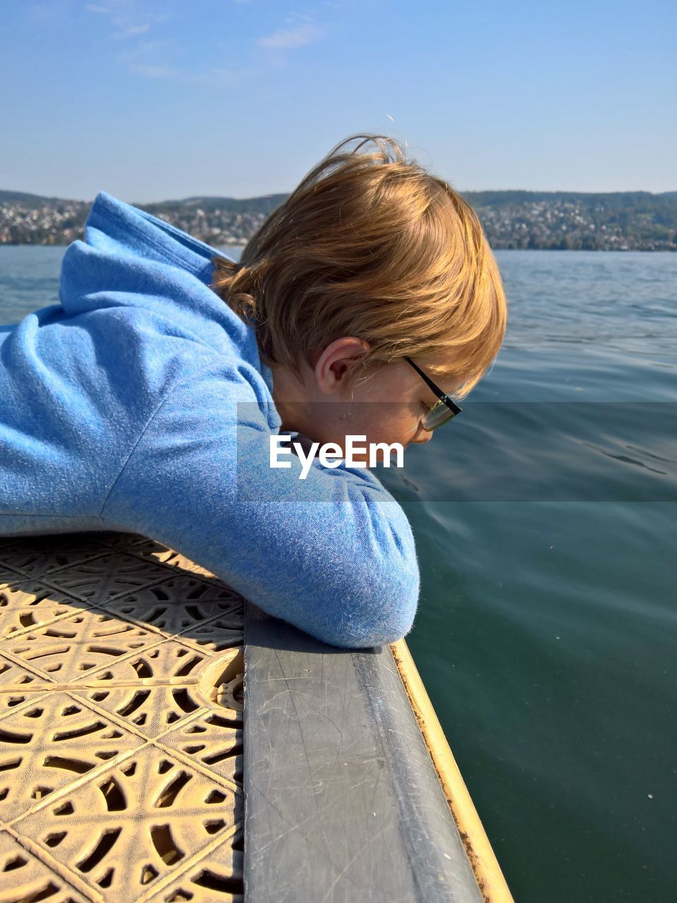 Side View Of Boy By Lake