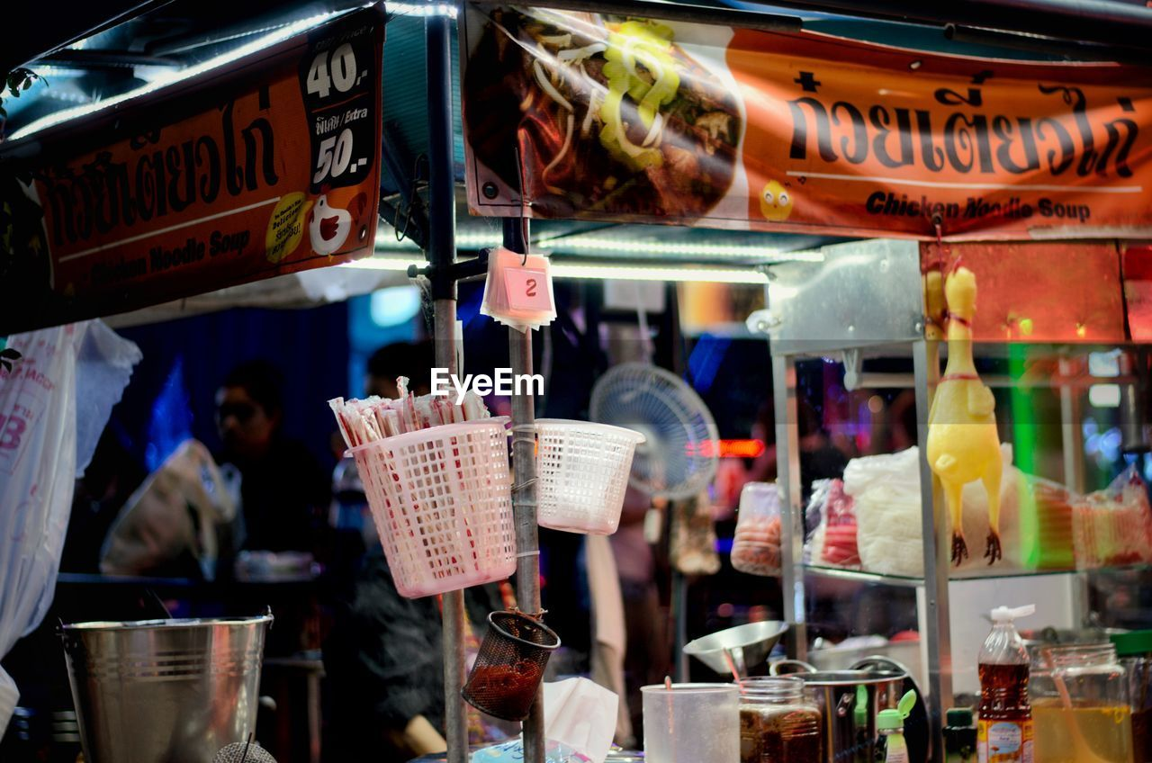 choice, retail, variation, for sale, market, container, large group of objects, business, shopping, store, food and drink, real people, market stall, small business, food, text, abundance, incidental people, indoors, illuminated, retail display, buying, sale